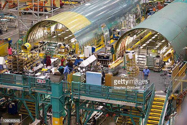 Boeing employees work on Boeing 777 passenger plane fuselage section on one of the assembly lines February 14 2011 at the company's factory in...
