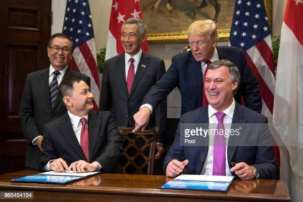 Boeing Executive Vice President Kevin McAllister and CEO of Singapore Airlines Goh Choon Phong along US President Donald Trump and Lee Hsien Loong of...