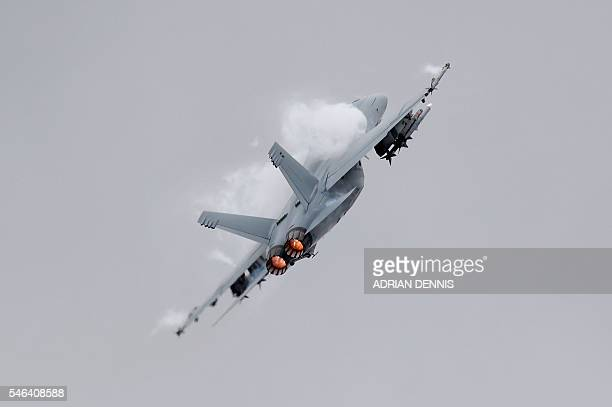 Boeing F/A18 Super Hornet a twinengine supersonic all weather multirole fighter takes part in a flying display at the Farnborough Airshow south west...