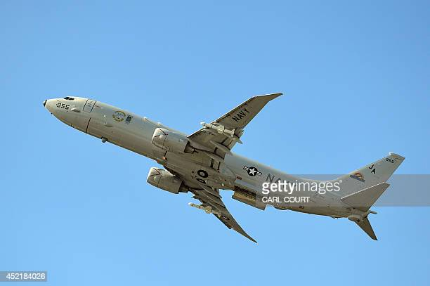 A Boeing P8A Poseidon is pictured during an air display on the second day of the Farnborough International Air show in Hampshire England on July 15...