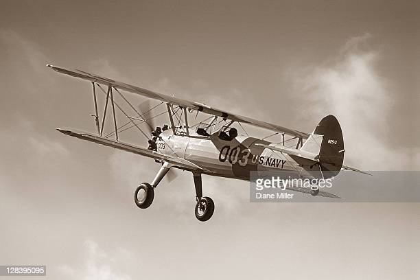 boeing stearman in authentically restored navy paint scheme, - 1943 stock pictures, royalty-free photos & images