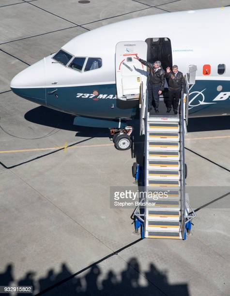 Boeing test pilots Jim Webb left and Keith Otsuka greet a crowd after completing the first flight of the Boeing 737 MAX 7 on March 16 2018 in Seattle...