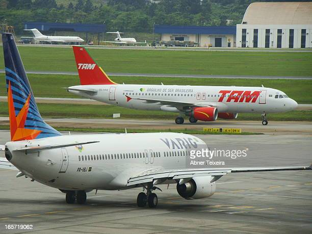 CONTENT] Boeing Varig 737 and Airbus A320 Tam Aeroporto internacional de Guarulhos São Paulo Brasil Terminal 1 Pátio movimento aeronaves