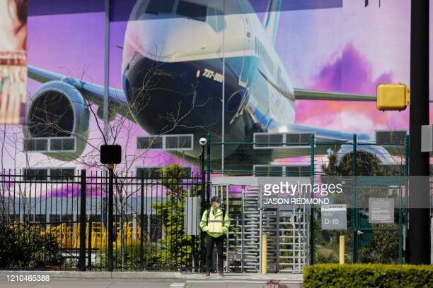 A Boeing worker in a face mask exits the Boeing Renton Factory where the Boeing 737 MAX airliners are built in Renton Washginton on April 20 2020...