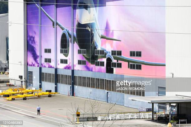 A Boeing worker is pictured walking at the Boeing Renton Factory where the Boeing 737 MAX airliners are built in Renton Washginton on April 20 2020...