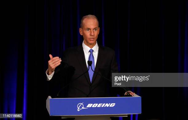 Boeing's Chairman President and CEO Dennis Muilenburg speaks during a news conference after Boeing's Annual Meeting of Shareholders at the Field...