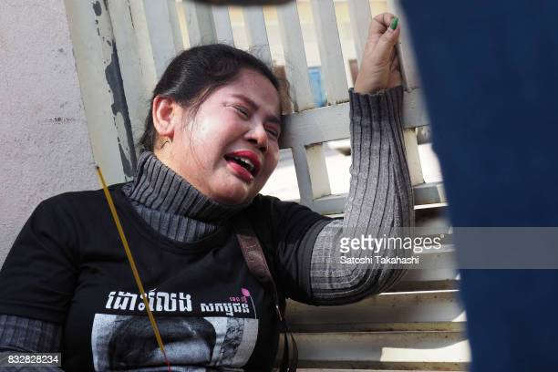 Boeng Kak community activist Bo Chhor Vy protests outside the Appeal Court after a judge upheld a 30month prison sentence against prominent land...
