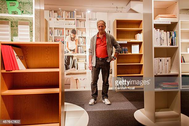 Boerje Lindgren originator and designer of the designed bookshelf named Billy poses between several shelves in the Ikea museum on November 08 2012 in...
