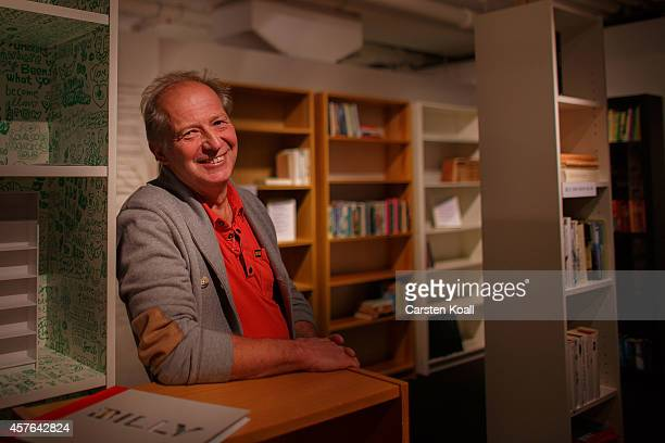 Boerje Lindgren originator and designer of the designed bookshelf named Billy poses sitting between several shelves in the Ikea museum on November 08...