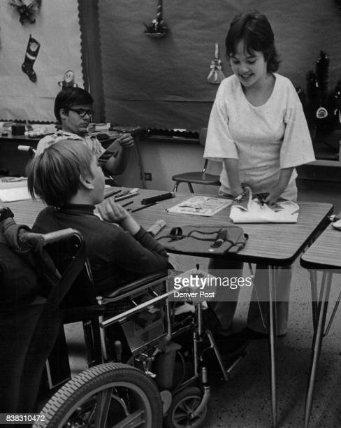 Boettcher School Students Angela Hiatt right and Joe Pilakowski in wheelchair left look over merchandise as sales clerk mark Urban watches Credit...