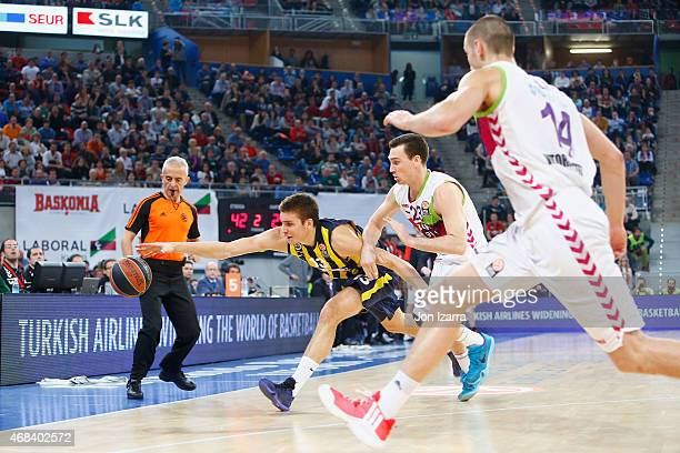 Bogdan Bogdanovic #13 of Fenerbahce Ulker Istanbul competes with Ben Hansbrough #23 of Laboral Kutxa Vitoria during the Turkish Airlines Euroleague...