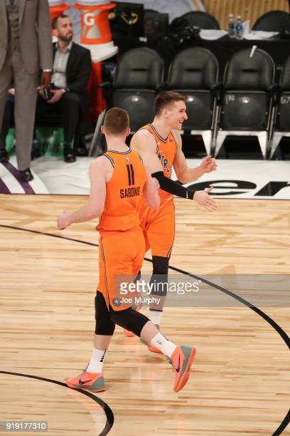 Bogdan Bogdanovic and Domantas Sabonis of the World Team high five during the game against the USA Team during the Mountain Dew Kickstart Rising...