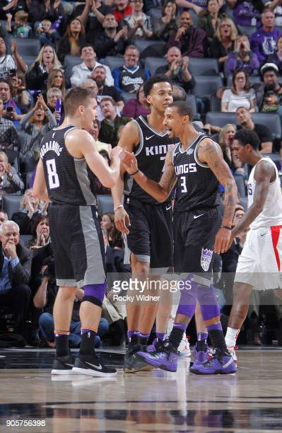 Bogdan Bogdanovic and George Hill of the Sacramento Kings face off against the Los Angeles Clippers on January 11 2018 at Golden 1 Center in...