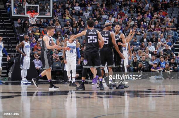 Bogdan Bogdanovic and Justin Jackson of the Sacramento Kings high five during the game against the Orlando Magic on March 9 2018 at Golden 1 Center...