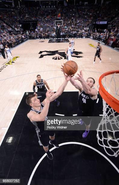 Bogdan Bogdanovic and Kosta Koufos of the Sacramento Kings rebound against the Orlando Magic on March 9 2018 at Golden 1 Center in Sacramento...