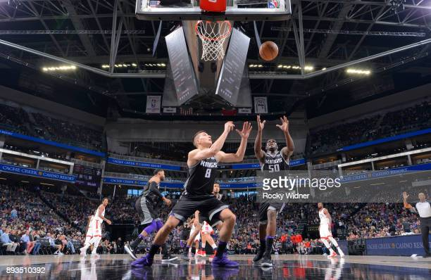 Bogdan Bogdanovic and Zach Randolph of the Sacramento Kings rebound against the Toronto Raptors on December 10 2017 at Golden 1 Center in Sacramento...