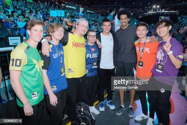 Bogdan Bogdanovic Jarrett Allen and Overwatch Team players attend Overwatch League Grand Finals Day 2 at Barclays Center on July 28 2018 in New York...