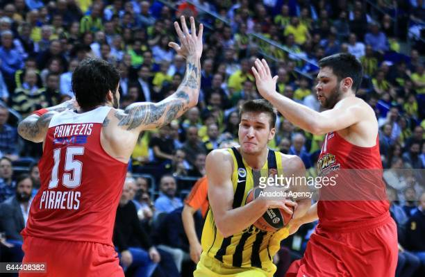 Bogdan Bogdanovic of Fenerbahce in action against Georgios Printezis and Kostas Papanikolaou of Olympiacos during the Turkish Airlines Euroleague...