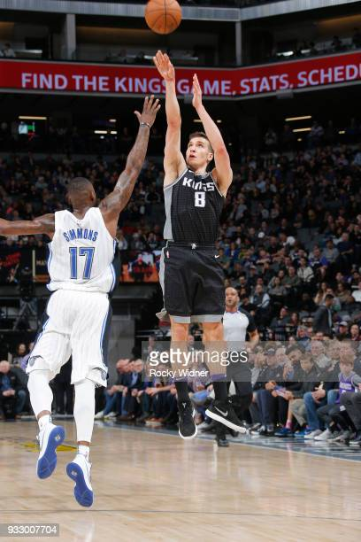 Bogdan Bogdanovic of he Sacramento Kings shoots a three pointer against Jonathon Simmons of the Orlando Magic on March 9 2018 at Golden 1 Center in...