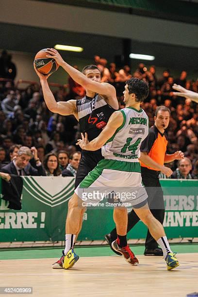 Bogdan Bogdanovic of Partizan NIS Belgrade tries to pass the ball against Trenton Meacham of JSF Nanterre during the game JSF Nanterre v Partizan NIS...