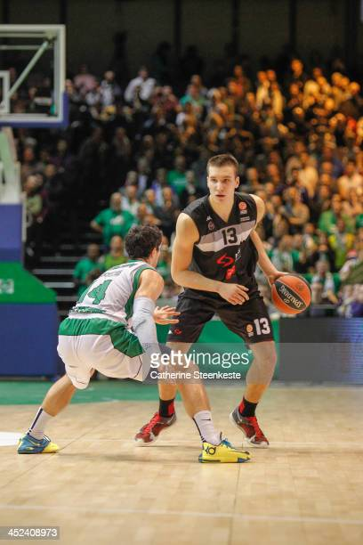Bogdan Bogdanovic of Partizan NIS Belgrade tries to set up a play against Trenton Meacham of JSF Nanterre during the game JSF Nanterre v Partizan NIS...