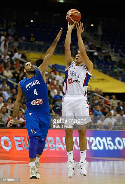 Bogdan Bogdanovic of Serbia drives to the basket against Pietro Aradori of Italy during the FIBA EuroBasket 2015 Group B basketball match between...