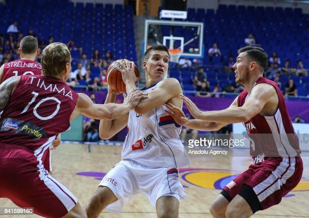 Bogdan Bogdanovic of Serbia in action against Dairis Bertans and Janis Timma of Latvia during the FIBA Eurobasket 2017 Group D Men's basketball match...