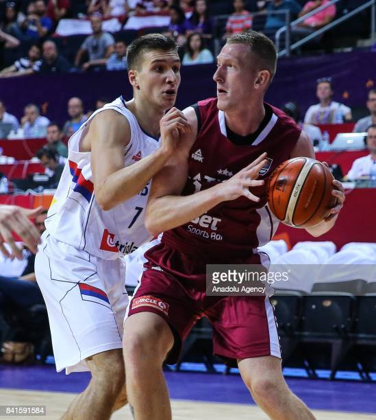 Bogdan Bogdanovic of Serbia in action against Rolands Smits of Latvia during the FIBA Eurobasket 2017 Group D Men's basketball match between Serbia...