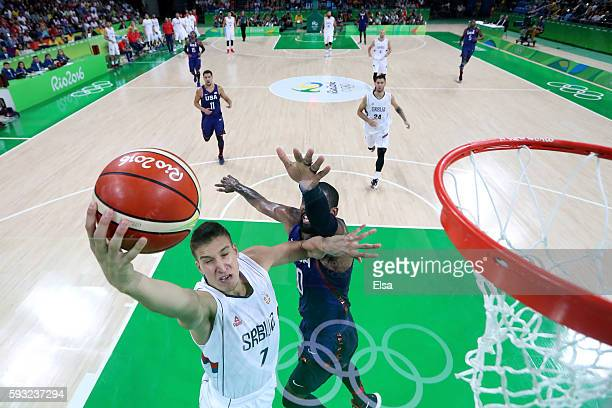 Bogdan Bogdanovic of Serbia makes a layup around Kyrie Irving of United States during the Men's Gold medal game on Day 16 of the Rio 2016 Olympic...