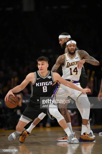 Bogdan Bogdanovic of the Sacramento Kings backs into Brandon Ingram of the Los Angeles Lakers at Staples Center on December 30 2018 in Los Angeles...
