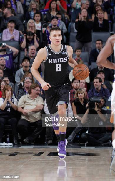 Bogdan Bogdanovic of the Sacramento Kings brings the ball up the court against the Phoenix Suns on December 12 2017 at Golden 1 Center in Sacramento...