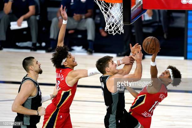 Bogdan Bogdanovic of the Sacramento Kings center right competes for an offensive rebound against New Orleans Pelicans' Frank Jackson right and...