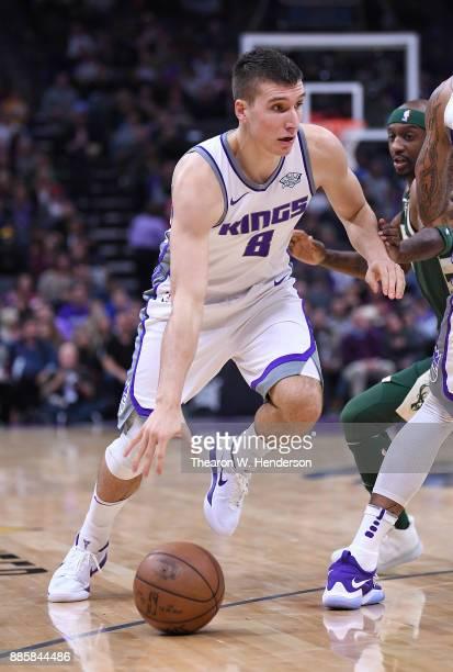 Bogdan Bogdanovic of the Sacramento Kings dribbles the ball against the Milwaukee Bucks during their NBA basketball game at Golden 1 Center on...