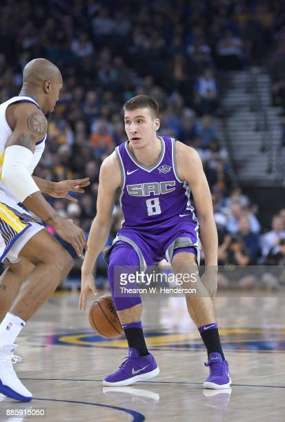 Bogdan Bogdanovic of the Sacramento Kings dribbles the ball against the Golden State Warriors during their NBA basketball game at ORACLE Arena on...