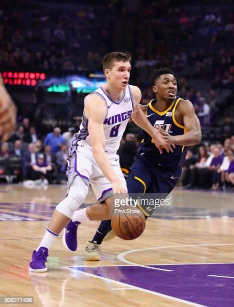 Bogdan Bogdanovic of the Sacramento Kings drives past Donovan Mitchell of the Utah Jazz at Golden 1 Center on January 17 2018 in Sacramento...