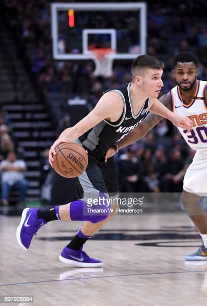 Bogdan Bogdanovic of the Sacramento Kings drives towards the basket against the Phoenix Suns during an NBA basketball game at Golden 1 Center on...