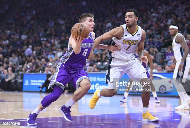 Bogdan Bogdanovic of the Sacramento Kings drives towards the basket on Trey Lyles of the Denver Nuggets during an NBA Basketball game at Golden 1...