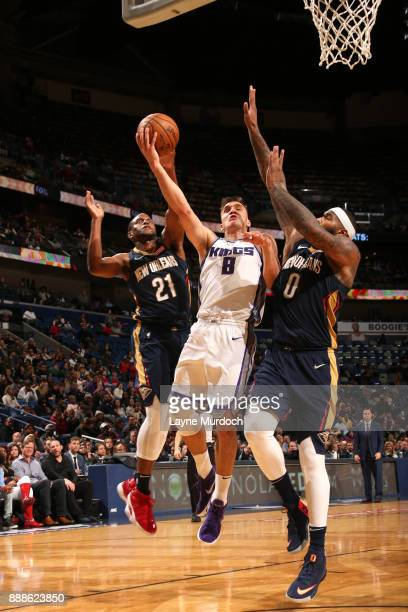 Bogdan Bogdanovic of the Sacramento Kings dunks against Darius Miller of the New Orleans Pelicans on December 8 2017 at Smoothie King Center in New...