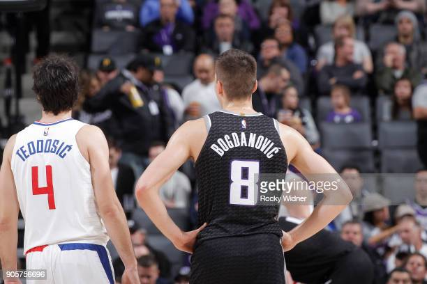 Bogdan Bogdanovic of the Sacramento Kings faces off against Milos Teodosic of the Los Angeles Clippers on January 11 2018 at Golden 1 Center in...