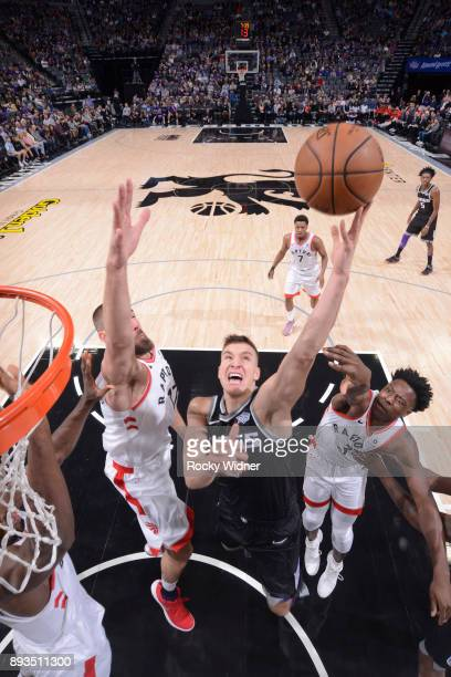 Bogdan Bogdanovic of the Sacramento Kings goes up for the shot against Jonas Valanciunas of the Toronto Raptors on December 10 2017 at Golden 1...