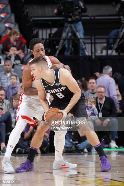 Bogdan Bogdanovic of the Sacramento Kings handles the ball against DeMar DeRozan of the Toronto Raptors on December 10 2017 at Golden 1 Center in...