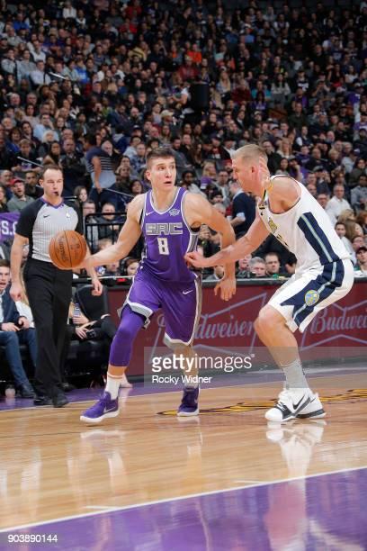 Bogdan Bogdanovic of the Sacramento Kings handles the ball against Mason Plumlee of the Denver Nuggets on January 6 2018 at Golden 1 Center in...