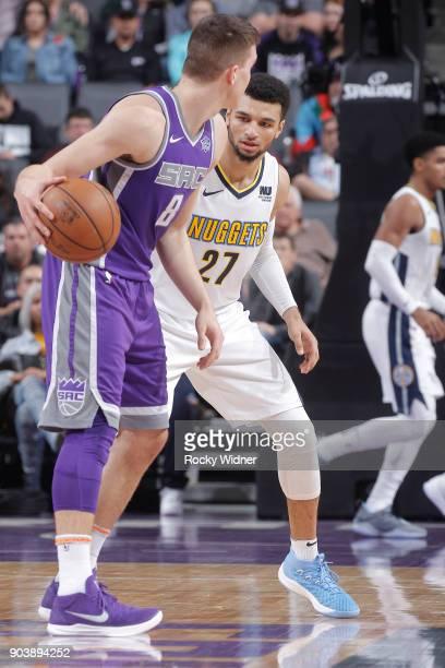 Bogdan Bogdanovic of the Sacramento Kings handles the ball against Jamal Murray of the Denver Nuggets on January 6 2018 at Golden 1 Center in...