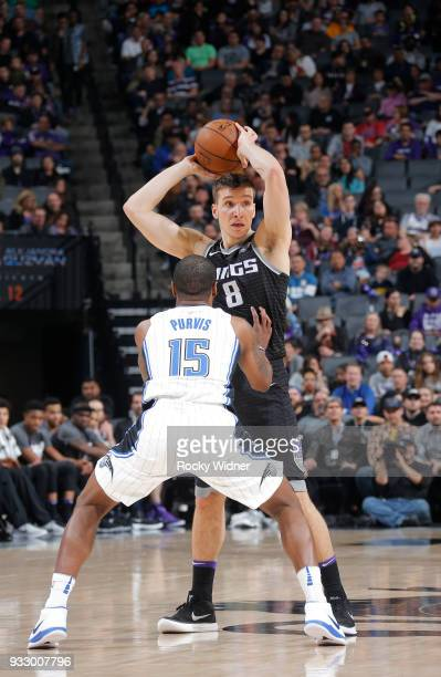 Bogdan Bogdanovic of the Sacramento Kings handles the ball against Rodney Purvis of the Orlando Magic on March 9 2018 at Golden 1 Center in...