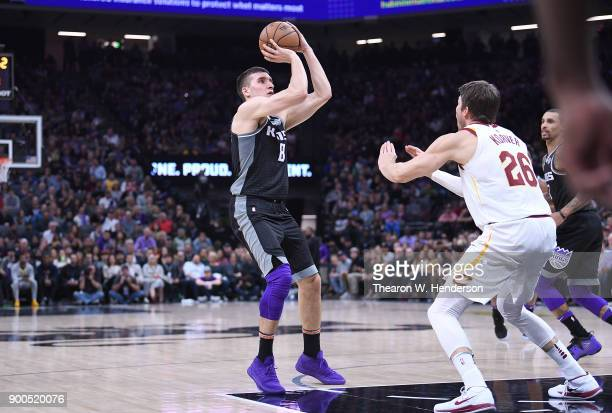Bogdan Bogdanovic of the Sacramento Kings looks to shoot over Kyle Korver of the Cleveland Cavaliers during their NBA basketball game at Golden 1...