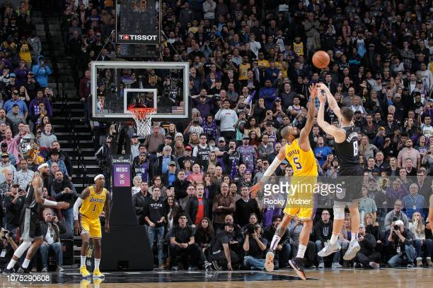 Bogdan Bogdanovic of the Sacramento Kings makes the game winning three point basket during the game against the Los Angeles Lakers on December 27...