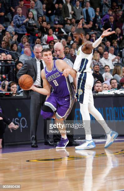 Bogdan Bogdanovic of the Sacramento Kings passes against Will Barton of the Denver Nuggets on January 6 2018 at Golden 1 Center in Sacramento...