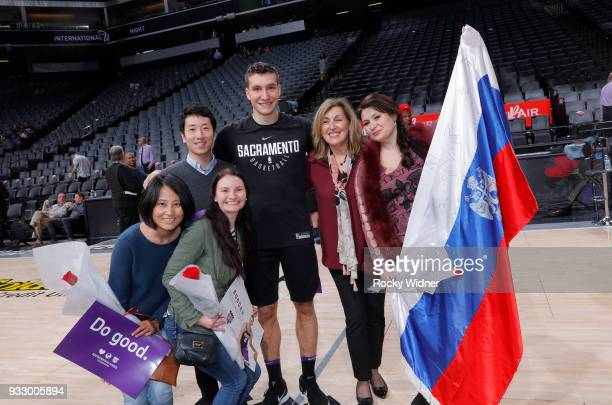 Bogdan Bogdanovic of the Sacramento Kings poses for a photo with fans during International Women's day prior to the game agains thte Orlando Magic on...