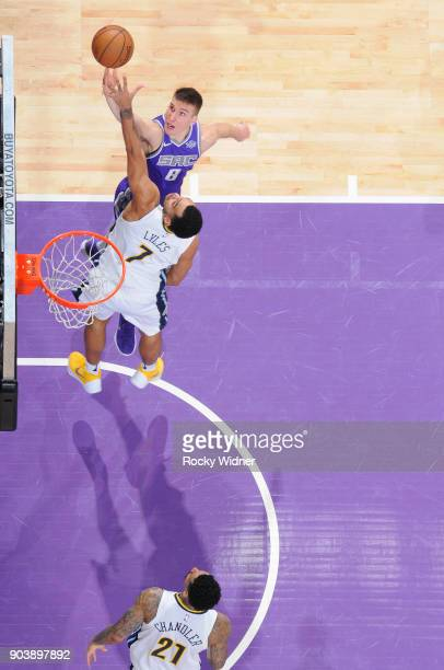 Bogdan Bogdanovic of the Sacramento Kings puts up a shot against Trey Lyles of the Denver Nuggets on January 6 2018 at Golden 1 Center in Sacramento...