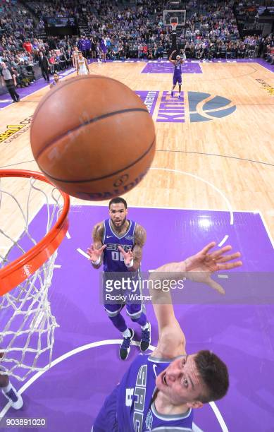 Bogdan Bogdanovic of the Sacramento Kings rebounds against the Denver Nuggets on January 6 2018 at Golden 1 Center in Sacramento California NOTE TO...